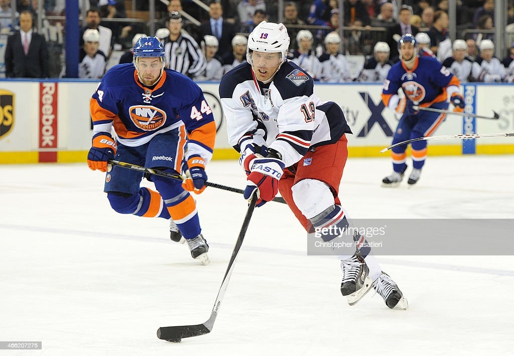 <a gi-track='captionPersonalityLinkClicked' href=/galleries/search?phrase=Brad+Richards&family=editorial&specificpeople=202622 ng-click='$event.stopPropagation()'>Brad Richards</a> #19 of the New York Rangers skates with the puck against <a gi-track='captionPersonalityLinkClicked' href=/galleries/search?phrase=Calvin+de+Haan&family=editorial&specificpeople=5660177 ng-click='$event.stopPropagation()'>Calvin de Haan</a> #44 of the New York Islanders during the third period on January 31, 2014 at Madison Square Garden in New York City.