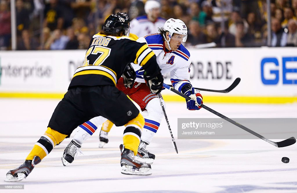 <a gi-track='captionPersonalityLinkClicked' href=/galleries/search?phrase=Brad+Richards&family=editorial&specificpeople=202622 ng-click='$event.stopPropagation()'>Brad Richards</a> #19 of the New York Rangers skates with the puck in front of Torey Krug #47 of the Boston Bruins in overtime in Game One of the Eastern Conference Semifinals during the 2013 NHL Stanley Cup Playoffs on May 16, 2013 at TD Garden in Boston, Massachusetts.