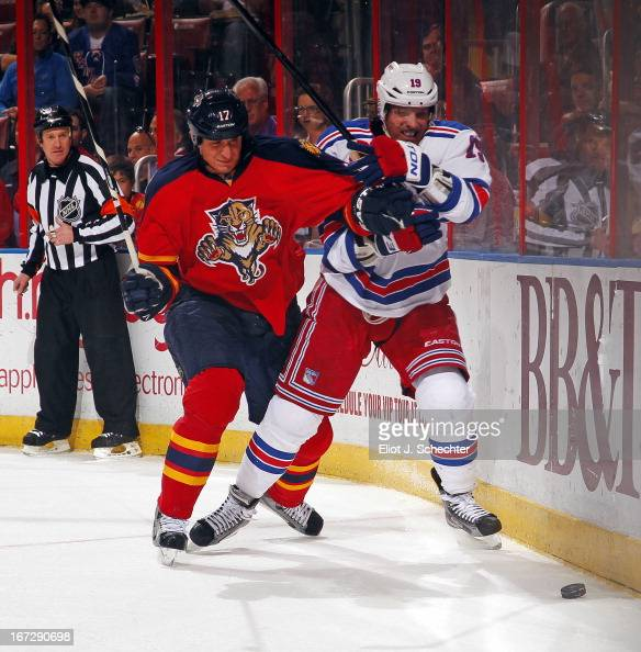 Brad Richards of the New York Rangers tangles with Filip Kuba of the Florida Panthers at the BBT Center on April 23 2013 in Sunrise Florida