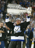 Brad Richards of the Tampa Bay Lightning holds the Stanley Cup above his head after the victory over the Calgary Flames in Game seven of the NHL...