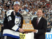 Brad Richards of the Tampa Bay Lightning receives the Conn Smythe MVP trophy from NHL Commissioner Gary Bettman after defeating the Calgary Flames 21...