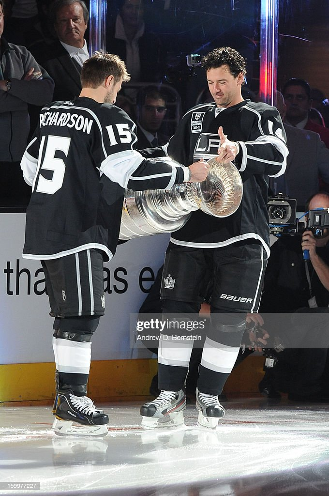 Brad Richardson #15 and Justin Williams #14 of the Los Angeles Kings hold the Stanley Cup prior to the game against the Chicago Blackhawks at Staples Center on January 19, 2013 in Los Angeles, California.