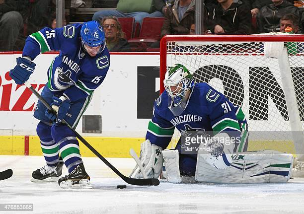 Brad Richardson handles a rebound in front of teammate Eddie Lack of the Vancouver Canucks during their NHL game against the Minnesota Wild at Rogers...