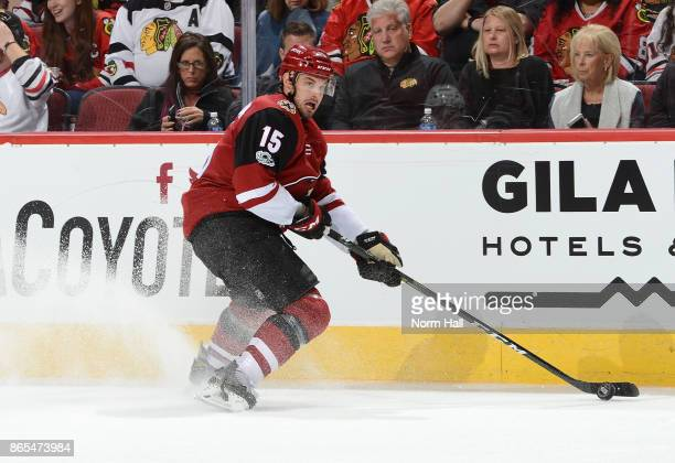 Brad Richardson of the Arizona Coyotes skates the puck up ice against the Chicago Blackhawks at Gila River Arena on October 21 2017 in Glendale...