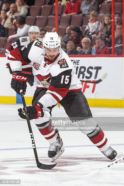 Brad Richardson of the Arizona Coyotes skates with the puck against the Ottawa Senators during an NHL game at Canadian Tire Centre on October 18 2016...
