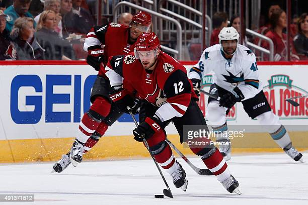 Brad Richardson of the Arizona Coyotes skates with the puck during the NHL preseason game against the San Jose Sharks at Gila River Arena on October...