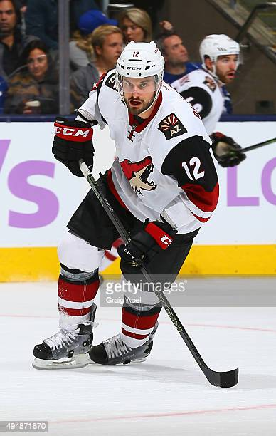 Brad Richardson of the Arizona Coyotes turns up ice against the Toronto Maple Leafs during game action on October 26 2015 at Air Canada Centre in...