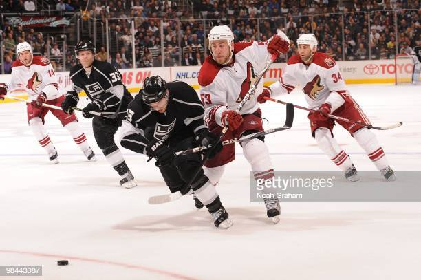 Brad Richardson of the Los Angeles Kings battles for position against Derek Morris of the Phoenix Coyotes on April 8 2010 at Staples Center in Los...