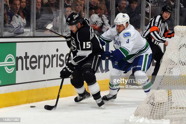 Brad Richardson of the Los Angeles Kings skates with the puck against Kevin Bieksa of the Vancouver Canucks in Game Four of the Western Conference...