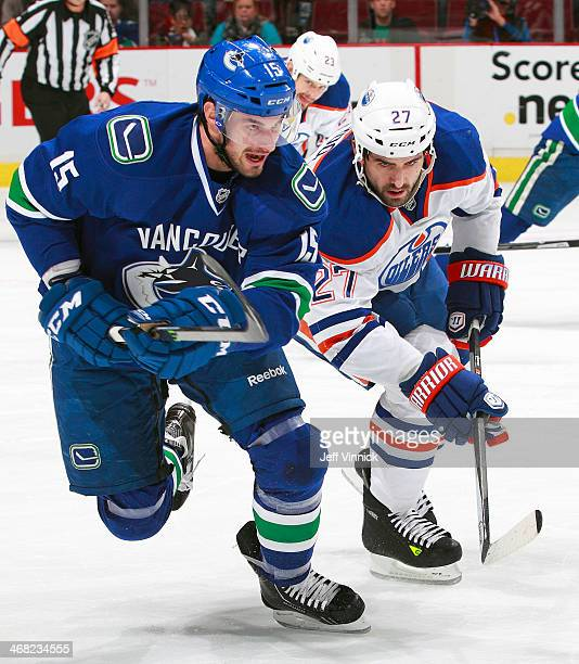 Brad Richardson of the Vancouver Canucks and Boyd Gordon of the Edmonton Oilers skate up ice during their NHL game at Rogers Arena January 27 2014 in...