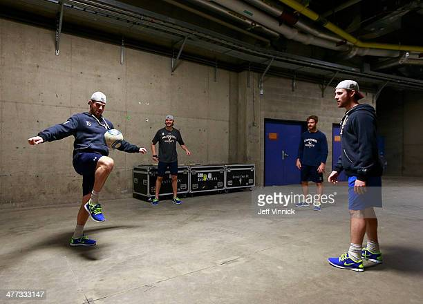 Brad Richardson of the Vancouver Canucks plays soccer with teammates during the 2014 Tim Hortons NHL Heritage Classic against the Ottawa Senators at...