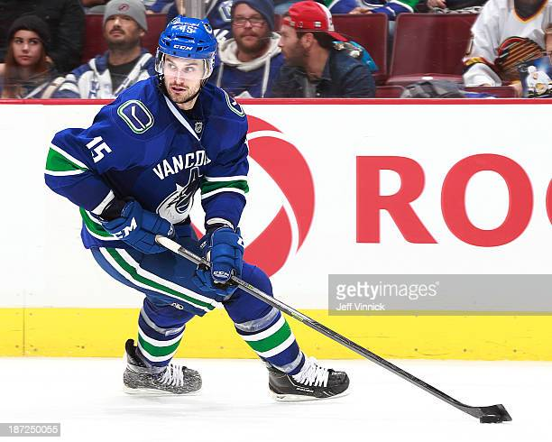 Brad Richardson of the Vancouver Canucks skates up ice with the puck during their NHL game against the Toronto Maple Leafs at Rogers Arena on...
