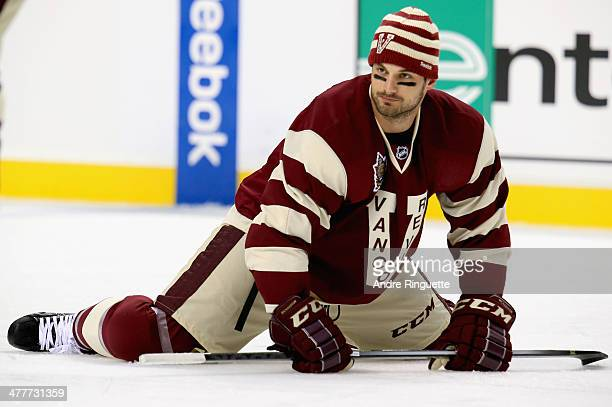 Brad Richardson of the Vancouver Canucks streches before playing the Ottawa Senators during the 2014 Tim Hortons NHL Heritage Classic game at BC...
