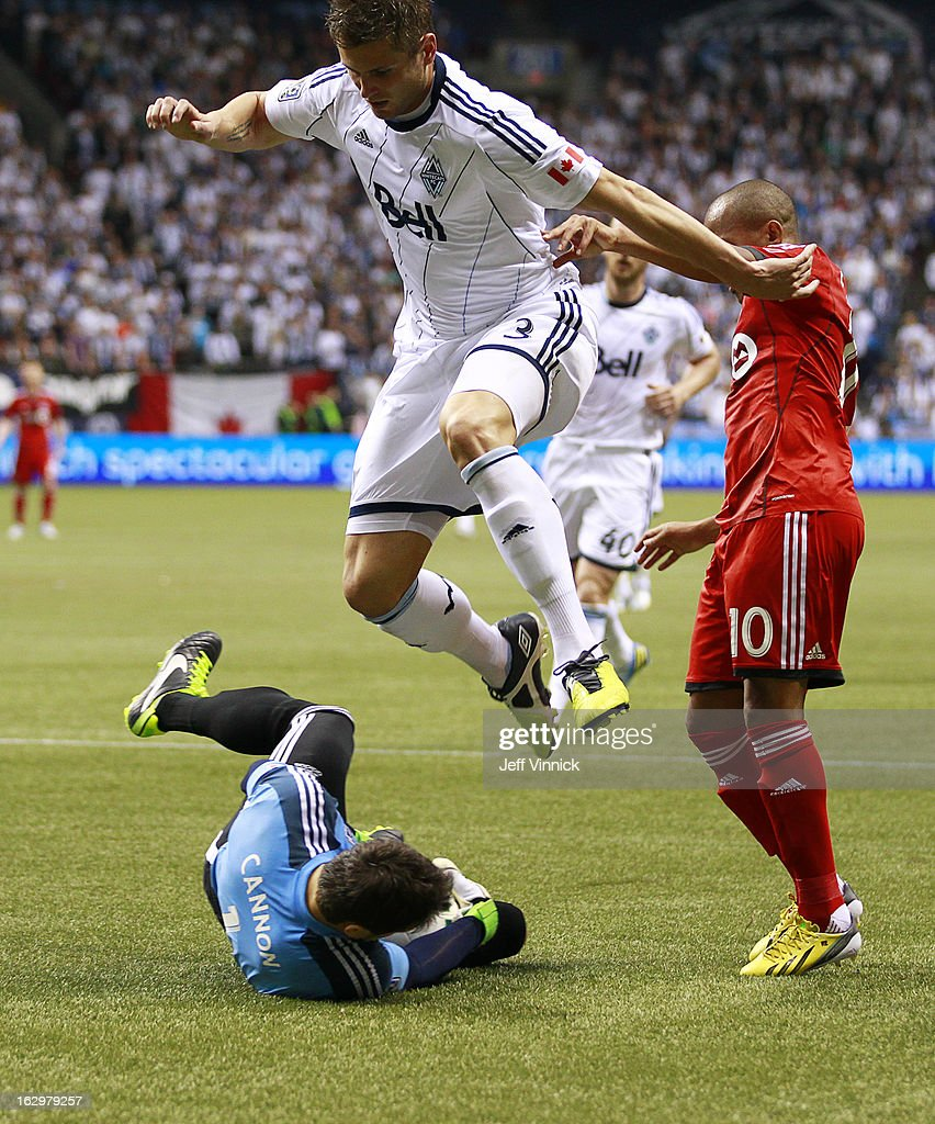 Brad Rusin #3 of the Vancouver Whitecaps FC leaps over goalkeeper Joe Cannon #1 of the Whitecaps while <a gi-track='captionPersonalityLinkClicked' href=/galleries/search?phrase=Robert+Earnshaw&family=editorial&specificpeople=208190 ng-click='$event.stopPropagation()'>Robert Earnshaw</a> #10 of the Toronto FC watches during their MLS game March 2, 2013 at B.C. Place in Vancouver, British Columbia, Canada. Vancouver won 1-0.