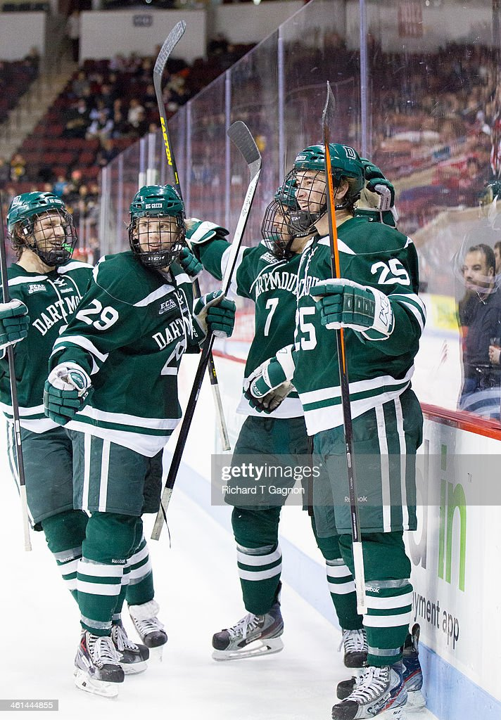 Brad Schierhorn #25 of the Dartmouth College Big Green celebrates his goal with his teammates Rick Pinkston #7, Andy Simpson #24 and Kyle Nickerson #29 during NCAA hockey action against the Boston University Terriers at Agganis Arena on January 8, 2014 in Boston, Massachusetts.