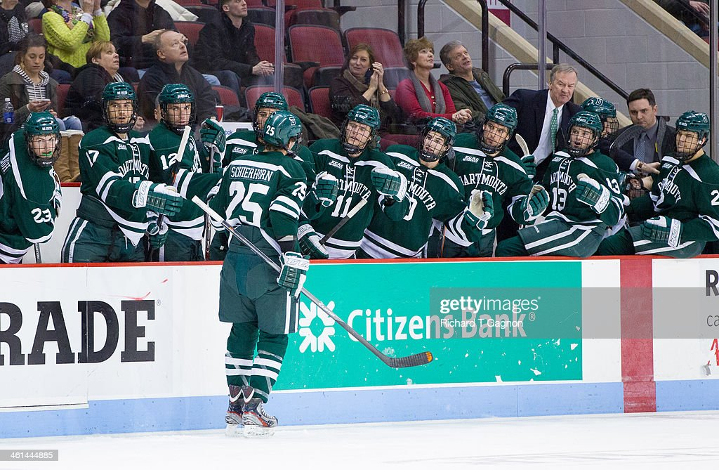 Brad Schierhorn #25 of the Dartmouth College Big Green celebrates his goal with his teammates during NCAA hockey action against the Boston University Terriers at Agganis Arena on January 8, 2014 in Boston, Massachusetts.