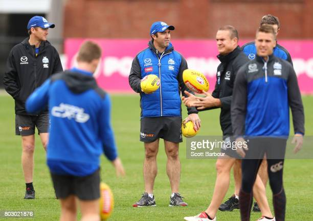 Brad Scott coach of the Kangaroos looks on during a North Melbourne Kangaroos AFL training session at Arden Street Ground on June 29 2017 in...