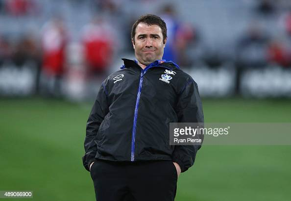 Brad Scott coach of the Kangaroos looks on during the First AFL Semi Final match between the Sydney Swans and the North Melbourne Kangaroos at ANZ...