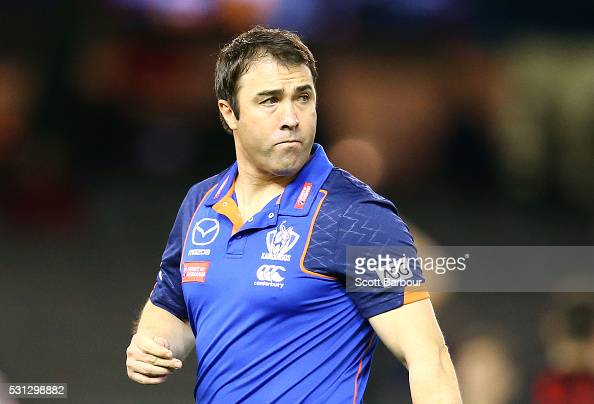Brad Scott coach of the Kangaroos looks on during the round eight AFL match between the Essendon Bombers and the North Melbourne Kangaroos at Etihad...