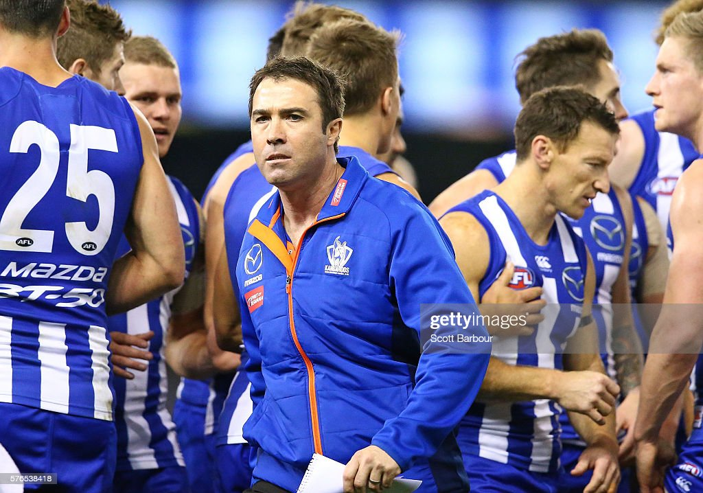 Brad Scott coach of the Kangaroos reacts after speaking to his team during a quarter time break during the round 17 AFL match between the North...