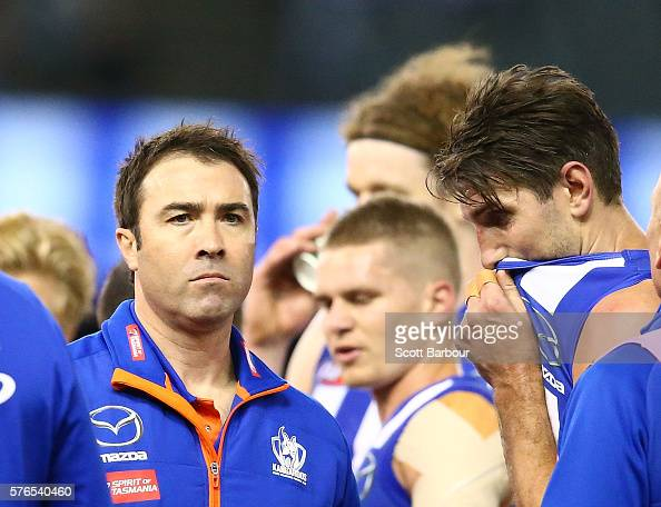 Brad Scott coach of the Kangaroos reacts after speaking to his team during a quarter time break as Jarrad Waite of the Kangaroos looks on during the...