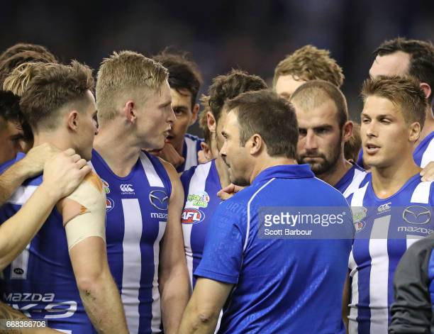 Brad Scott coach of the Kangaroos speaks to his team during a quarter time break during the round four AFL match between the North Melbourne...