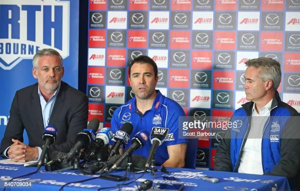 Brad Scott coach of the Kangaroos speaks to the media along with Kangaroos CEO Managing Director Carl Dilena and Kangaroos Chairman Ben Buckley...