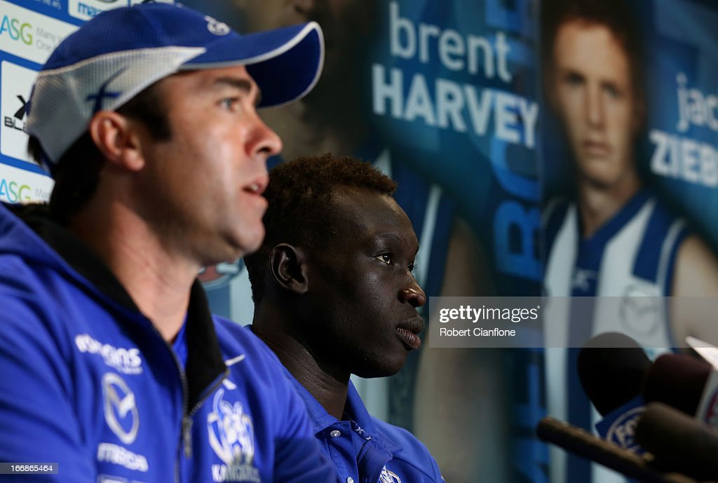 Brad Scott coach of the Kangaroos speaks to the media as Majak Daw listens during a North Melbourne Kangaroos AFL media session at Aegis Park on April 18, 2013 in Melbourne, Australia.