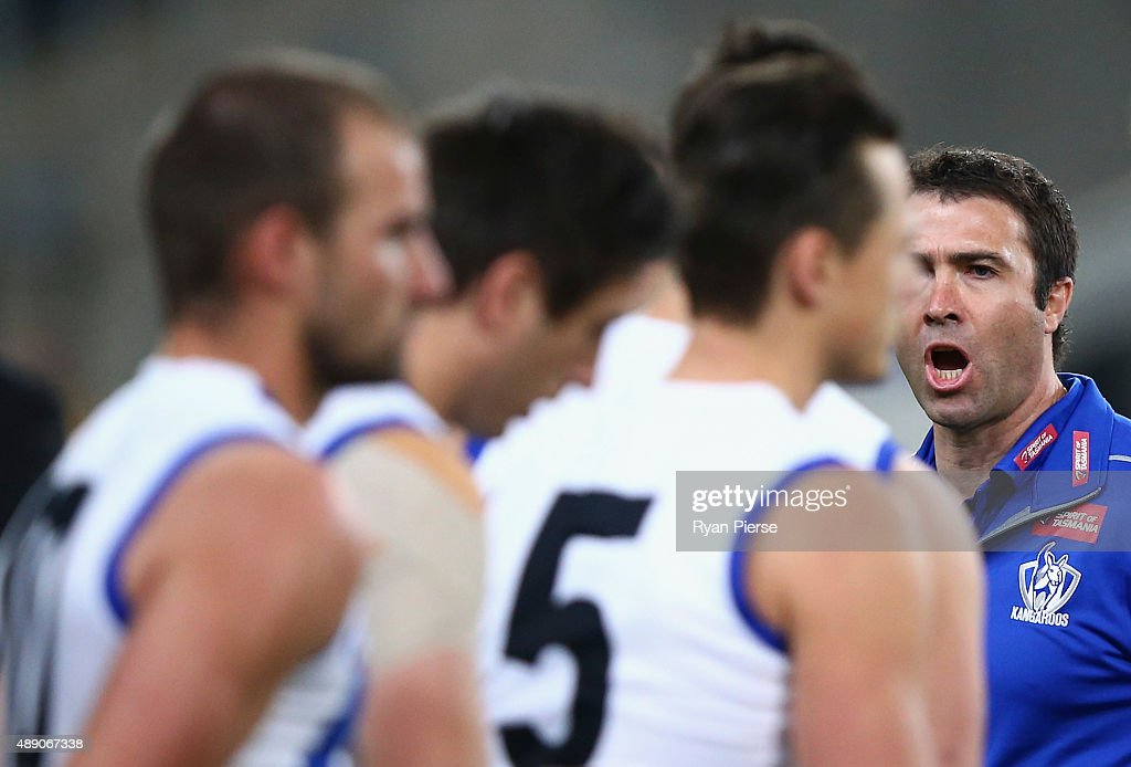 Brad Scott coach of the Kangaroos talks to his players during the First AFL Semi Final match between the Sydney Swans and the North Melbourne...