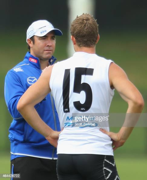 Brad Scott coach of the Kangaroos talks to Nick Dal Santo of the Kangaroos during a North Melbourne Kangaroos AFL media session at NMFC on February...