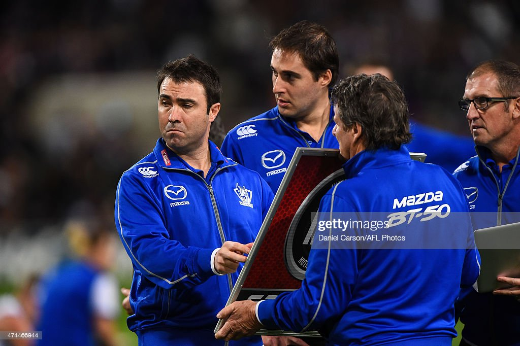 Brad Scott coach of the North Melbourne Kangaroos prepares his matchup board at quarter time during the round eight AFL match between the Fremantle...