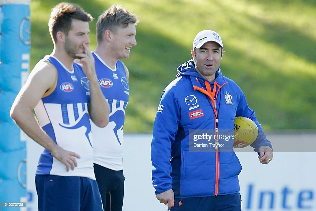 Brad Scott Senior Coach of the Kangaroos and Jack Ziebell share a joke during a North Melbourne Kangaroos AFL training session at Arden Street Ground...