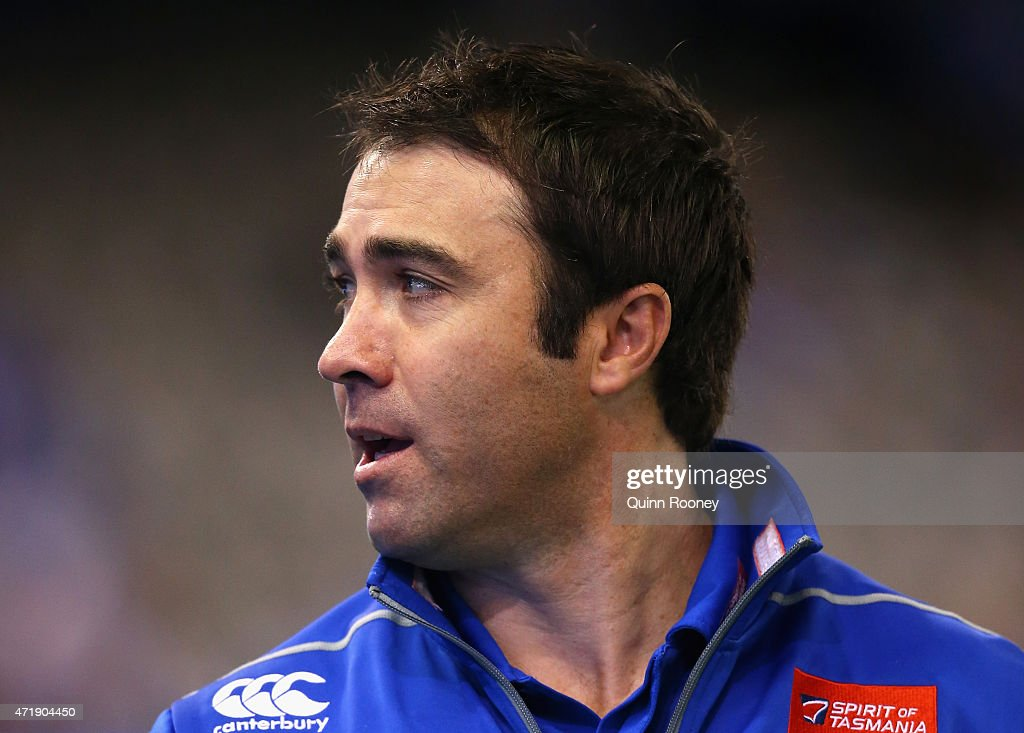 Brad Scott the coach of the Kangaroos looks on during the round five AFL match between the North Melbourne Kangaroos and the Hawthorn Hawks at Etihad...