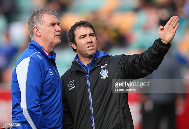 Brad Scott the coach of the Kangaroos talks to Geoff Walsh during the round six AFL match between the North Melbourne Kangaroos and the Richmond...