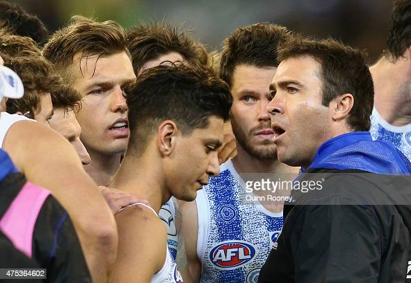 Brad Scott the coach of the Kangaroos talks to his players during the round nine AFL match between the Collingwood Magpies and the North Melbourne...