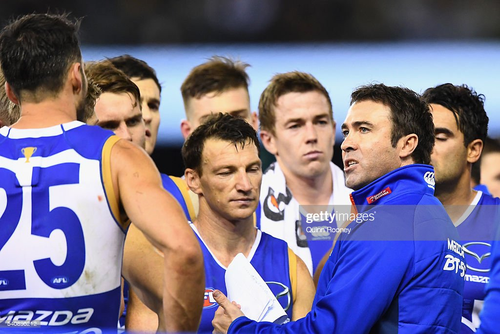 Brad Scott the coach of the Kangaroos talks to his players during the round 13 AFL match between the North Melbourne Kangaroos and the Hawthorn Hawks...