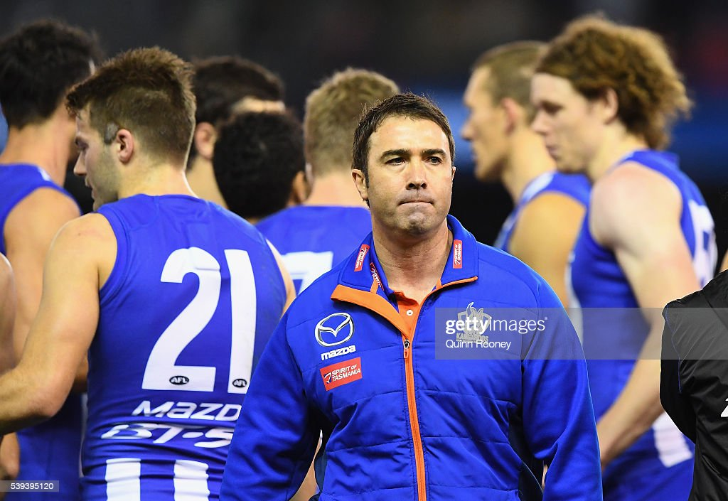 Brad Scott the coach of the Kangaroos walks away from talking to his players during the round 12 AFL match between the Geelong Cats and the North...