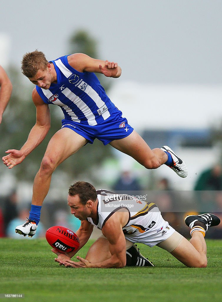 Brad Sewell (R) of the Hawks contests for the ball against Kieran Harper of the Kangaroos during the AFL NAB Cup match between the North Melbourne Kangaroos and the Hawthorn Hawks at Highgate Recreational Reserve on March 16, 2013 in Craigieburn, Australia.