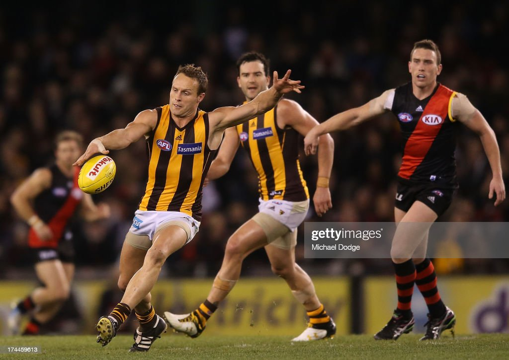 Brad Sewell of the Hawks kicks the ball during the round 18 AFL match between the Essendon Bombers and the Hawthorn Hawks at Etihad Stadium on July 26, 2013 in Melbourne, Australia.