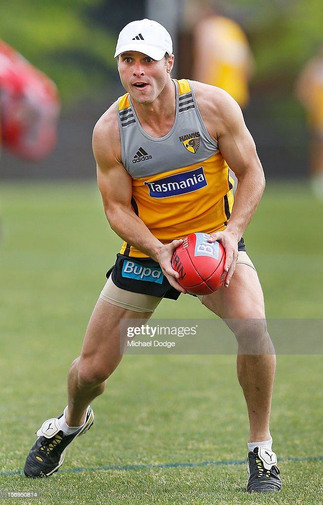 Brad Sewell runs with the ball during a Hawthorn Hawks pre-season AFL training session at Waverley Park on November 26, 2012 in Melbourne, Australia.