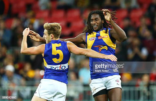 Brad Sheppard and Nic Naitanui of the Eagles celebrate a goal during the round 21 AFL match between the Greater Western Sydney Giants and the West...