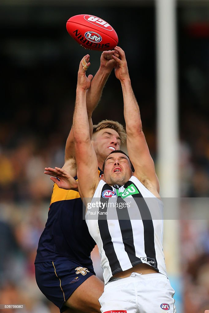 Brad Sheppard of the Eagles and Levi Greenwood of the Magpies contest a mark during the round six AFL match between the West Coast Eagles and the Collingwood Magpies at Domain Stadium on May 1, 2016 in Perth, Australia.