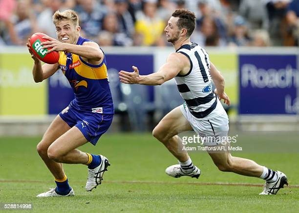 Brad Sheppard of the Eagles is tackled by Darcy Lang of the Cats during the 2016 AFL Round 07 match between the Geelong Cats and the West Coast...