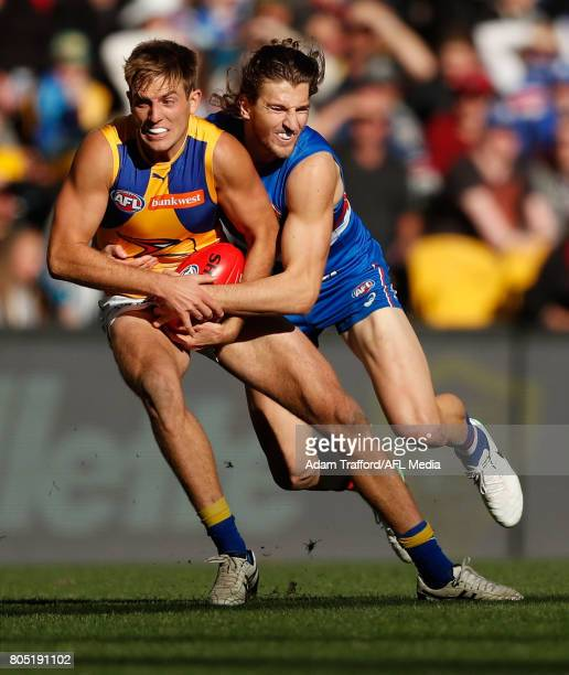 Brad Sheppard of the Eagles is tackled by Marcus Bontempelli of the Bulldogs during the 2017 AFL round 15 match between the Western Bulldogs and the...