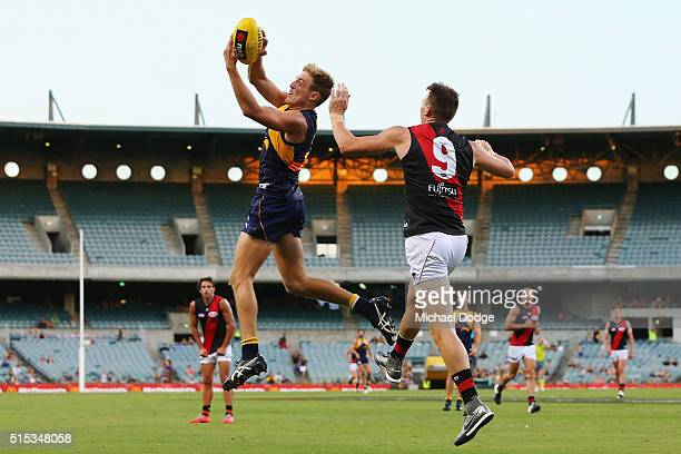 Brad Sheppard of the Eagles marks the ball against Brendon Goddard of the Bombers during the NAB Challenge AFL match between the West Coast Eagles...