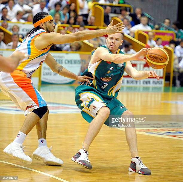 Brad Sheridan of the Crocodiles gets a pass away despite the defence of Luke Whitehead of the Blaze during the NBL Quarter Final match between the...