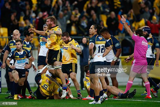 Brad Shields of the Hurricanes celebrates the try scored by Ardie Savea during the Super Rugby Semi Final match between the Hurricanes and the...