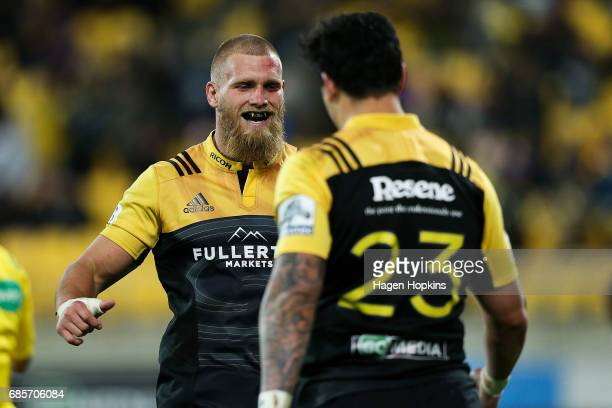 Brad Shields of the Hurricanes congratulates Ben Lam on his try during the round 13 Super Rugby match between the Hurricanes and the Cheetahs at...