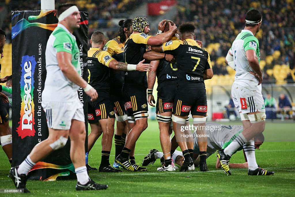 <a gi-track='captionPersonalityLinkClicked' href=/galleries/search?phrase=Brad+Shields+-+Rugby+Player&family=editorial&specificpeople=14741764 ng-click='$event.stopPropagation()'>Brad Shields</a> of the Hurricanes is congratulated on his try during the round 14 Super Rugby match between the Hurricanes and the Highlanders at Westpac Stadium on May 27, 2016 in Wellington, New Zealand.