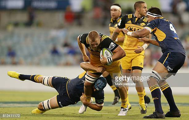 Brad Shields of the Hurricanes is tackled by Scott Fardy of the Brumbies during the round one Super Rugby match between the Brumbies and the...